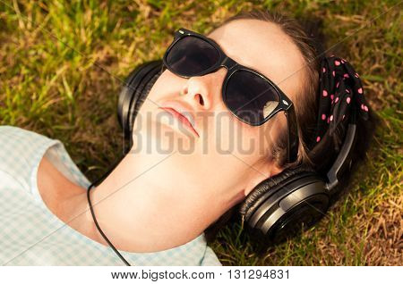 Close-up Of Woman Wearing Headphones And Listening To Music