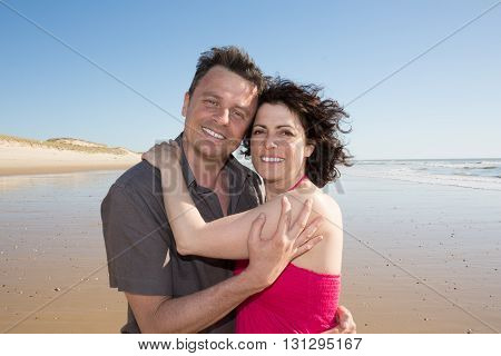 Loving Couple Spendingtime Together At The Beach