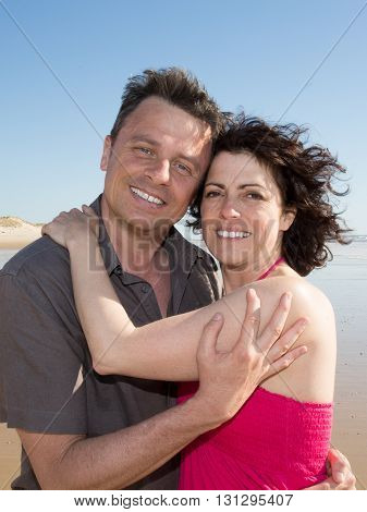 Loving Couple Spending Leisure Time Together At Beach