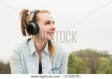 Closeup Portrait Of Beautiful Smiling Woman With Headphones