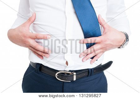 Businessman In Closeup Holds His Stomach Because Of Bloating