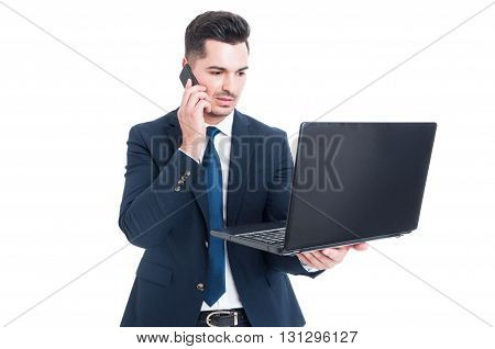 Handsome Businessman Talking On Smartphone And Working On Laptop