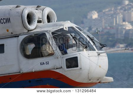 Gelendzhik Russia - September 9 2010: Kamov Ka-32 rescue helicopter with its crew in the cockpit