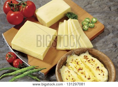 cheese and fried cheese on a wooden base