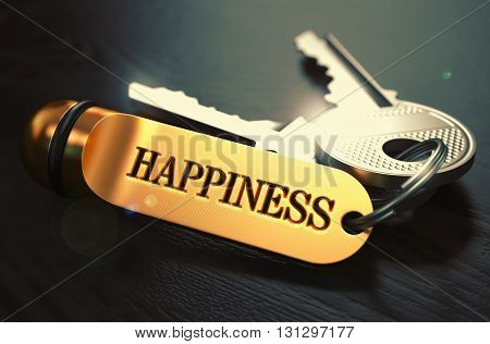 Happiness - Concept on Golden Keychain over Black Wooden Background. Closeup View, Selective Focus, 3D Render. Toned Image.