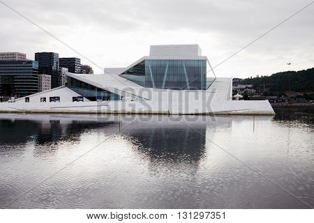 OSLO, NORWAY - JUNE 29, 2013: The Opera House in Oslo Norway. The building is situated in the central Oslo at the head of the Oslofjord. It was built in 2007 and was opened on April 12 2008.