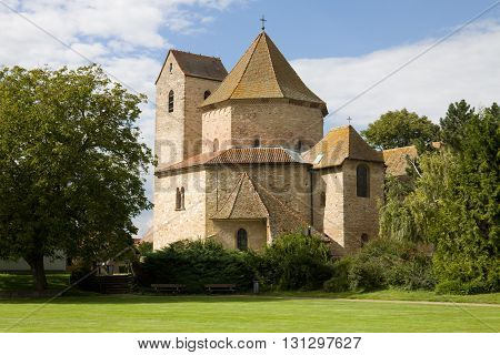 The abbey church in Ottmarsheim France. Ottmarsheim is a village in the Haut-Rhin department of the Alsace region. The church of Ottmarsheim (11th century) was originally an abbey church. The building has a centred plan similar to the Palatine chapel in A