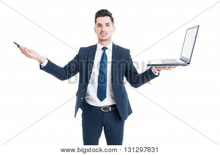 Business and technology concept with handsome businessman holding laptop and cellphone isolated on white background