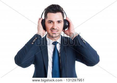 Portrait Of Attractive Salesman With Earphones Listening Music