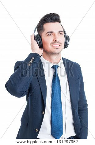 Relaxed Smiling Businessman Or Banker Enjoying Music On Headphones