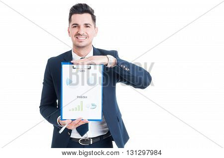 Statistics And Business Concept With Handsome Businessman Showing Charts