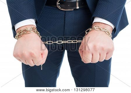 Businessman in handcuffs arrested and punished for bribery in close-up view isolated on white