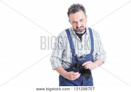 Portrait Of Unhappy Mechanic With Wrench Holding Empty Wallet