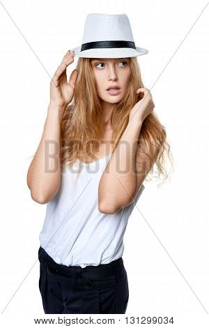 Beautiful slytish woman posing in fedora hat, over white background