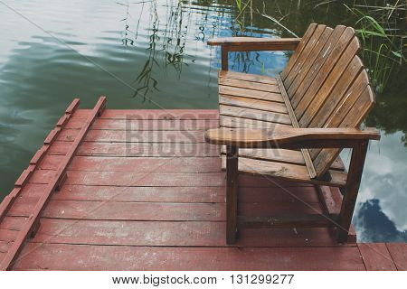 Wooden bench for resting on the lake