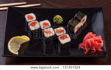 Japanese tasty sushi set. Different types of rolls on plates.