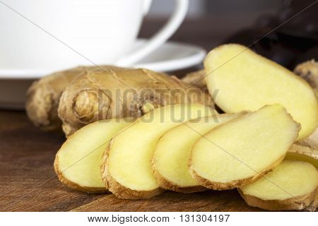 the ginger root on a wooden table