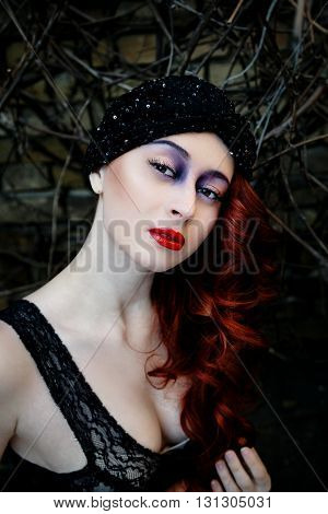 Beautiful redheaded woman face with bright make up