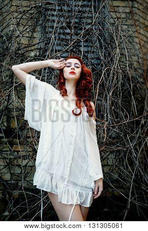 Sexy Beautiful young redhead girl posing outdoors