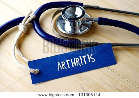 Medical Conceptual Image With Arthritis Word Written On Label Tag And Stethoscope On Wooden Backgrou