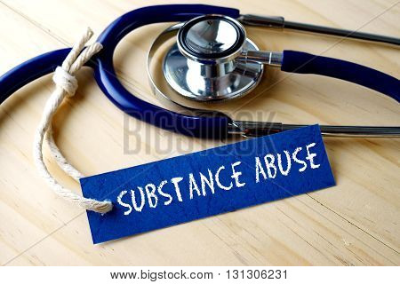 Medical Conceptual Image With Substance Abuse Word Written On Label Tag And Stethoscope On Wooden Ba