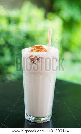 cream, sugar milk shake in the cafe garden