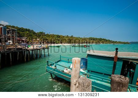 Summer seascape on tropical island Koh Rong in Cambodia. Landscape with shipyard.