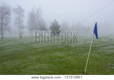 Empty golf course on a cold and foggy day