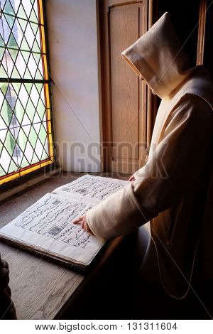 PLETERJE, SLOVENIA - NOVEMBER 06: The monks studying reading old medieval books in the Carthusian monastery in Pleterje, Slovenia on November 06, 2015.