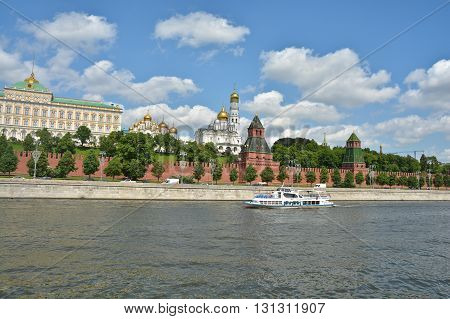 Kremlin embankment on a summer day. Moscow Kremlin and Moscow river in June.