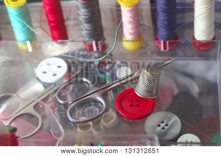 sewing kit spools of thread scissors thimble tailor buttons needles and pins