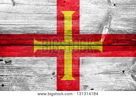 Flag Of Guernsey, Painted On Old Wood Plank Background