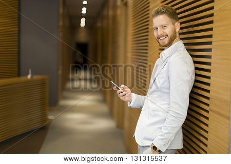 Redhair Businessman With Phone In The Office