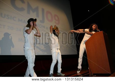 NEW YORK NY: OCT 21, 2009: Musician Andrew W.K. greeting fans onstage during the keynote address for the 2003 CMJ Music Marathon and Arts Festival at New York University