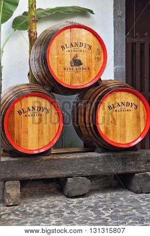 MADEIRA  ISLAND, PORTUGAL - OCTOBER 8, 2011: Classic huge oak barrels of wine  Madera. Storage of wine well-known firm