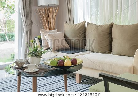 Modern Living Room Design With Round Glass Table On Carpet
