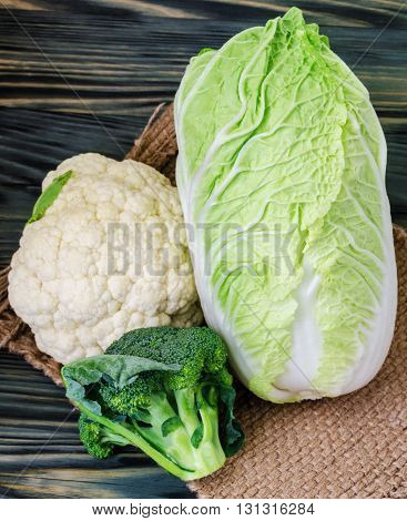 Broccoli cauliflower and cabbage on a rustic background
