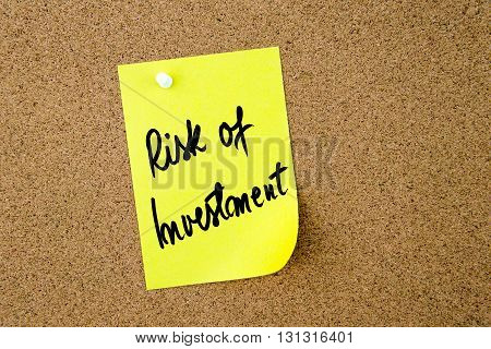 Risk Of Investment Written On Yellow Paper Note