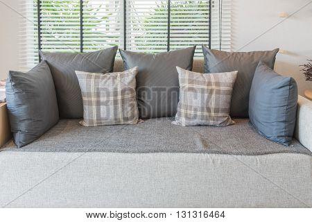 Set Of Pillows On Modern Sofa In Modern Living Room