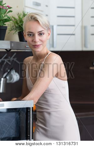 Portrait of beautiful girl posing in wave oven