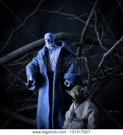 BLOOMFIELD NJ - MAY 22 2016:   Recreation of a scene from Star Wars The Empire Strikes Back with Jedi Master Yoda and Obi Wan Kenobi on Dagobah using Hasbro Action Figures.