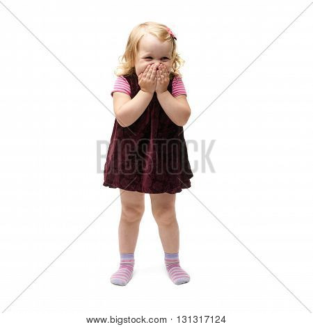 Young little girl with curly hair and closing mouth hands in purple dress standing over isolated white background