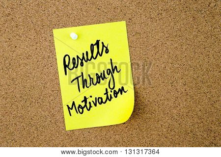 Results Through Motivation Written On Yellow Paper Note
