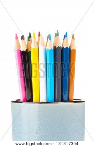colored pencils in a glass on white background
