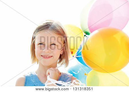 Happy little child playing with colorful balloons