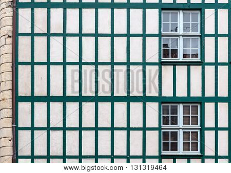 Windows On A White Wall With Old Wooden Beams.