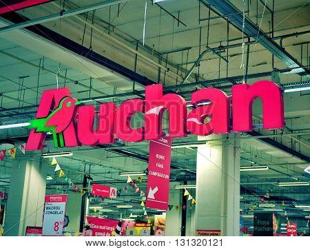 TIMISOARA ROMANIA - MAY 2: Logotype of Auchan hypermarket on May 2 2016. Auchan is a global food stores chain founded in France.