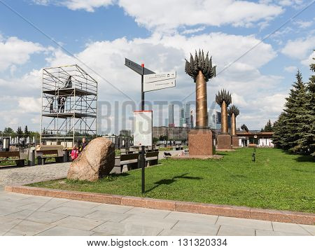 Moscow - May 6 2016: Index and map in Victory Park people walk and workers assemble decorations for the celebration of Victory Day May 6 2016 Moscow Russia