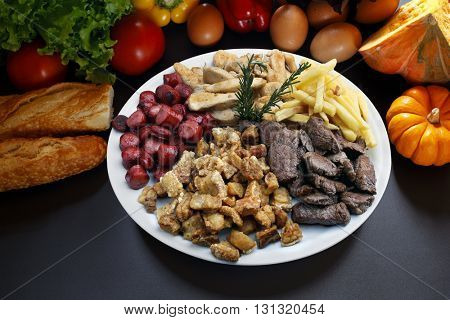 snacks meat, potatoes, sausage, cracklings