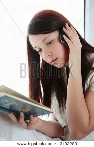 Beautiful girl with book: education, fashion.